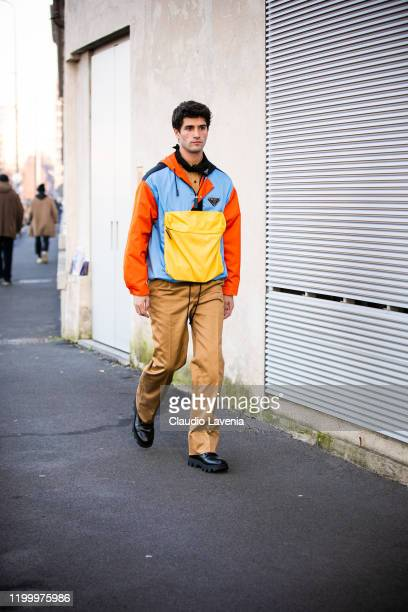 Marc Forne, wearing a colorful Prada jacket, beige pants and black shoes, is seen outside the Prada show during the Milan Men's Fashion Week on...