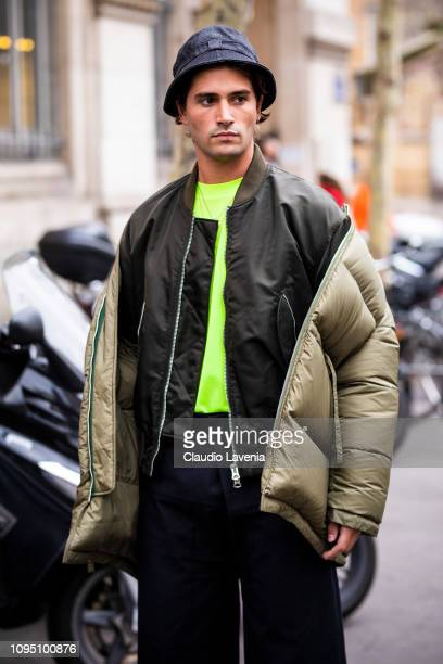 Marc Forne wearing a neon green tshirt black light weight jacket light green puffed jacked and black pants is seen in the streets of Paris before the...