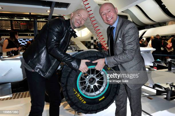 Marc Foster and Georges Kern visit the IWC booth during the Salon International de la Haute Horlogerie 2013 at Palexpo on January 22, 2013 in Geneva,...