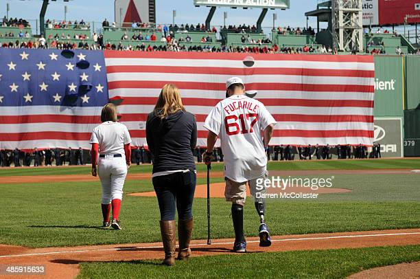 Marc Fucarile injured in last years Boston Marathon bombings prepares to throw out the first pitch prior to the Boston Red Sox/ Baltimore Orioles...