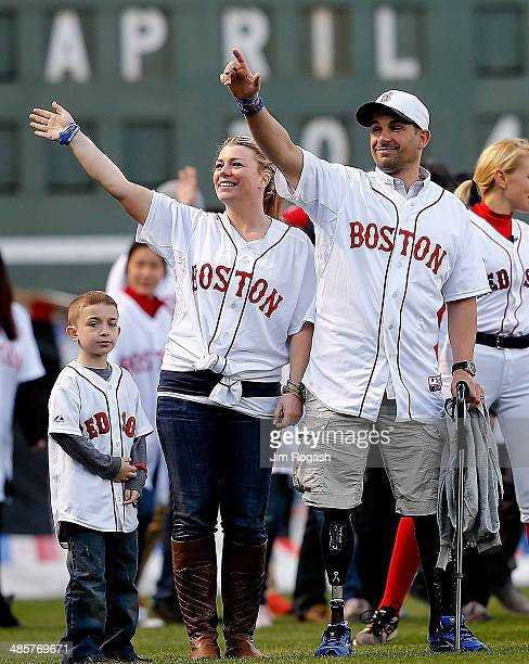 Marc Fucarile survivor of the 2013 Boston Marathon bombing and his wife Jen Regan react during a ceremony at Fenway Park before a game between Boston...
