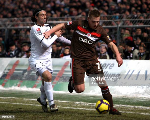 Marc Gallego of Frankfurt and Rouwen Hennings of St Pauli battle for the ball during the Second Bundesliga match between FC St Pauli and FSV...