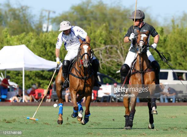 Marc Ganzi of Richard Mille looks back as Diego Cavanagh of Valiente plays the ball during The Palm Beach Open on March 15 2020 at the Grand...