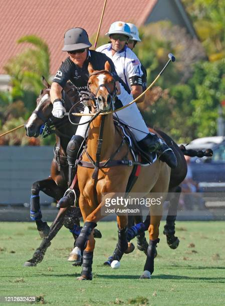 Marc Ganzi of Richard Mille plays the ball in front of Adolfo Cambiaso of Valiente during The Palm Beach Open on March 15 2020 at the Grand Champions...