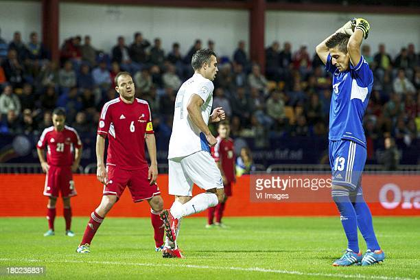 Marc Garcia Renom of Andorra Ildefons Lima Sola of Andorra Robin van Persie of Holland goalkeeper Ferran Pol Perez of Andorra during the FIFA 2014...