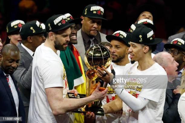 Marc Gasol and Danny Green of the Toronto Raptors celebrate with the Larry O'Brien Championship Trophy after his team defeated the Golden State...