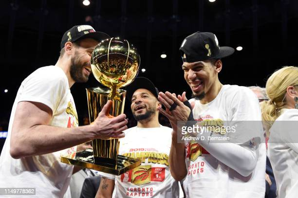 Marc Gasol and Danny Green of the Toronto Raptors hold up the Larry O'Brien Championship Trophy after Game Six of the NBA Finals against the Golden...