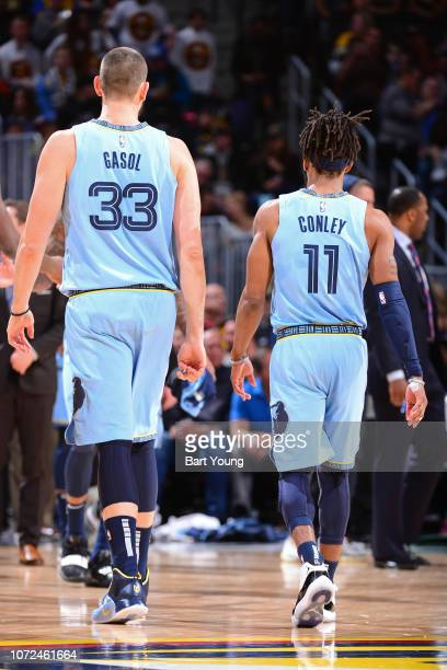 Marc Gasol and Mike Conley of the Memphis Grizzlies walk off the court during the game against the Denver Nuggets on December 10 2018 at the Pepsi...