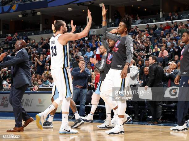 Marc Gasol exchanges high fives with teammate Deyonta Davis of the Memphis Grizzlies during the game against the Indiana Pacers on November 15 2017...