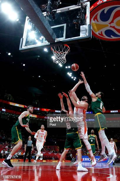 Marc Gasol of Spain goes for a shot over Australian players from left, Matthew Dellavedova and Andrew Bogut during the semi-finals of 2019 FIBA World...