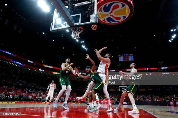 Marc Gasol of Spain puts a shot over Australian players from left, Andrew Bogut, Patty Mills and Joe Ingles during the semi-finals of 2019 FIBA World...