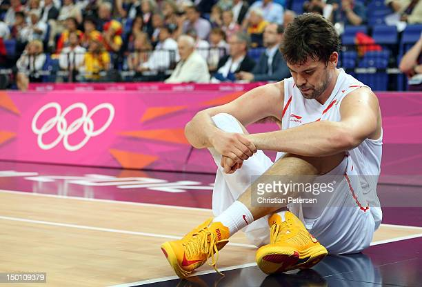 Marc Gasol of Spain reacts as he sits on the baseline in the first half while taking on Russia during the Men's Basketball semifinal match on Day 14...