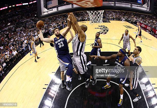 Marc Gasol of the Memphis Grizzlies attempts a shot in the first half against Tim Duncan of the San Antonio Spurs during Game One of the Western...