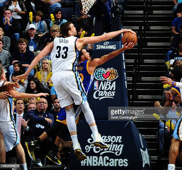 Marc Gasol of the Memphis Grizzlies blocks a shot by Stephen Curry of the Golden State Warriors on December 16 2014 at the FedEx Forum in Memphis...