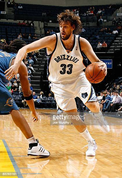 Marc Gasol of the Memphis Grizzlies drives past Etan Thomas of the Washington Wizards during the preseason game on October 8 2008 at FedExForum in...