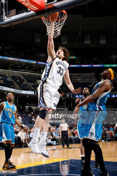 Marc Gasol of the Memphis Grizzlies dunks over James Posey of the New Orleans Hornets on February 9, 2009 at FedExForum in Memphis, Tennessee. NOTE...