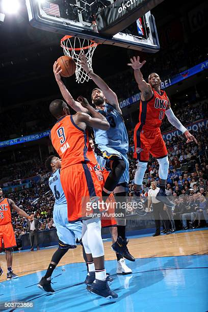 Marc Gasol of the Memphis Grizzlies goes to the basket against Serge Ibaka of the Oklahoma City Thunder on January 6 2016 at Chesapeake Energy Arena...