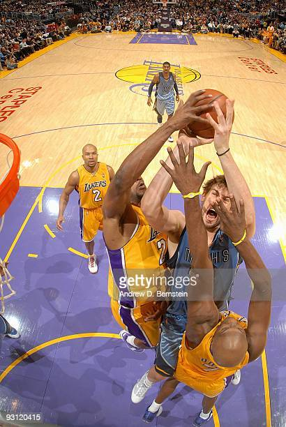 Marc Gasol of the Memphis Grizzlies goes to the basket under pressure against DJ Mbenga and Lamar Odom of the Los Angeles Lakers during the game on...