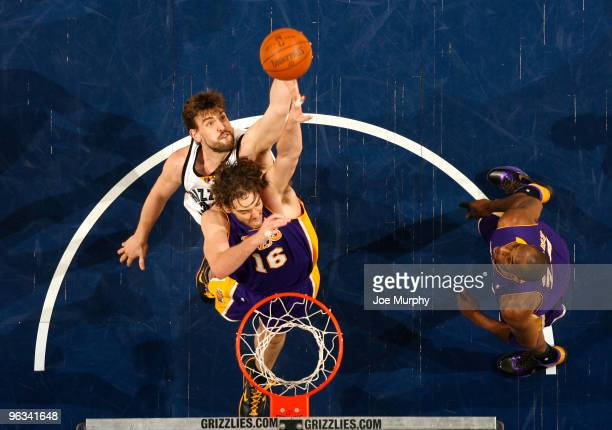 Marc Gasol of the Memphis Grizzlies grabs a rebound over brother Pau Gasol of the Los Angeles Lakers on February 1 2010 at FedExForum in Memphis...