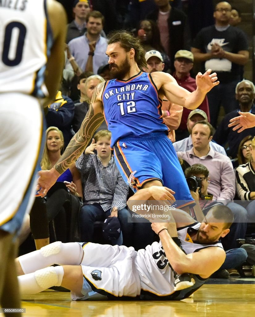 Marc Gasol #33 of the Memphis Grizzlies grabs the leg of Steven Adams #12 of the Oklahoma City Thunder during the second half of a 103-100 Thunder victory at FedExForum on April 5, 2017 in Memphis, Tennessee.