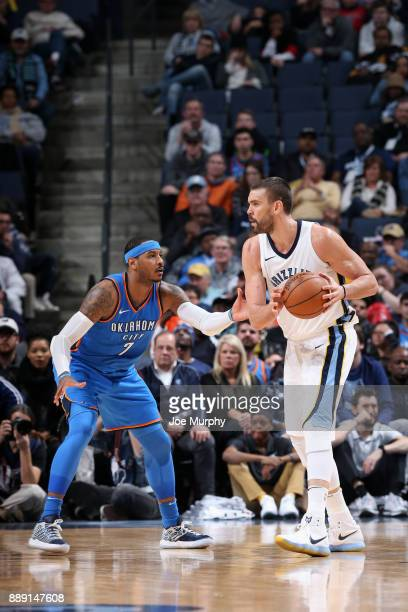Marc Gasol of the Memphis Grizzlies handles the ball against Carmelo Anthony of the Oklahoma City Thunder on December 9 2017 at FedExForum in Memphis...