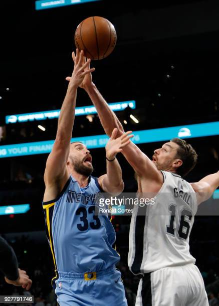 Marc Gasol of the Memphis Grizzlies has his shot blocked by Pau Gasol of the San Antonio Spurs at ATT Center on March 5 2018 in San Antonio Texas...