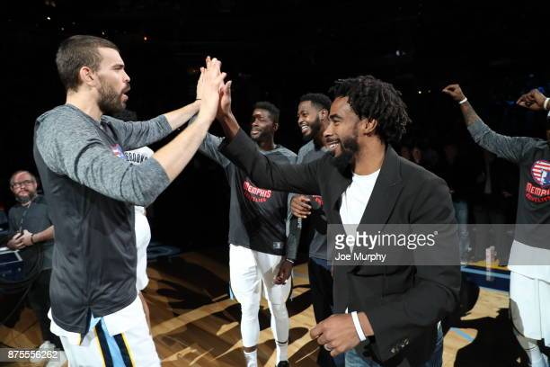 Marc Gasol of the Memphis Grizzlies high fives teammate Mike Conley before the game on November 15 2017 at FedExForum in Memphis Tennessee NOTE TO...