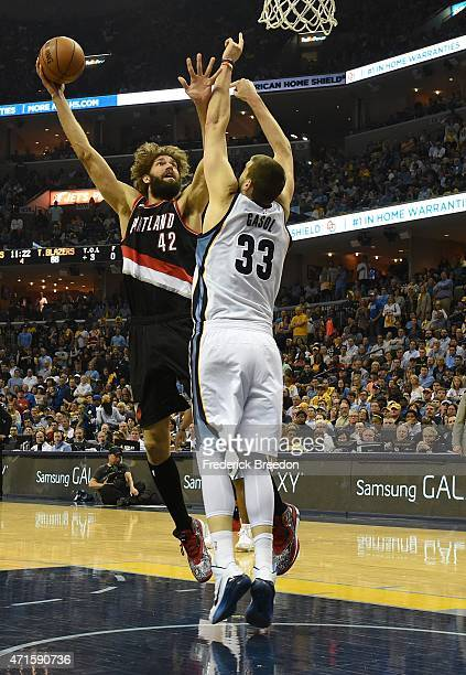 Marc Gasol of the Memphis Grizzlies jumps to block a shot by Robin Lopez of the Portland Trailblazers during the second half of Game 5 of the first...