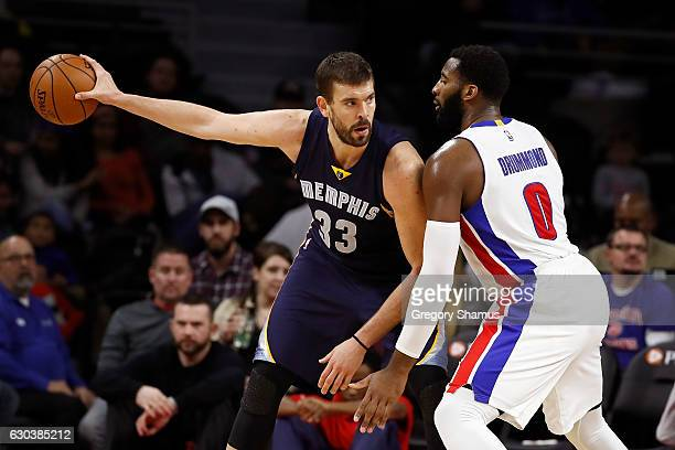 Marc Gasol of the Memphis Grizzlies looks to make a move against Andre Drummond of the Detroit Pistons during the second half at the Palace of Auburn...