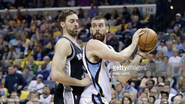 Marc Gasol of the Memphis Grizzlies looks to pass the ball while defended by Pau Gasol of the San Antonio Spurs in game four of the Western...