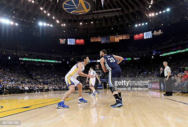 Marc Gasol of the Memphis Grizzlies looks to put a move on Zaza Pachulia of the Golden State Warriors during an NBA basketball game at ORACLE Arena...