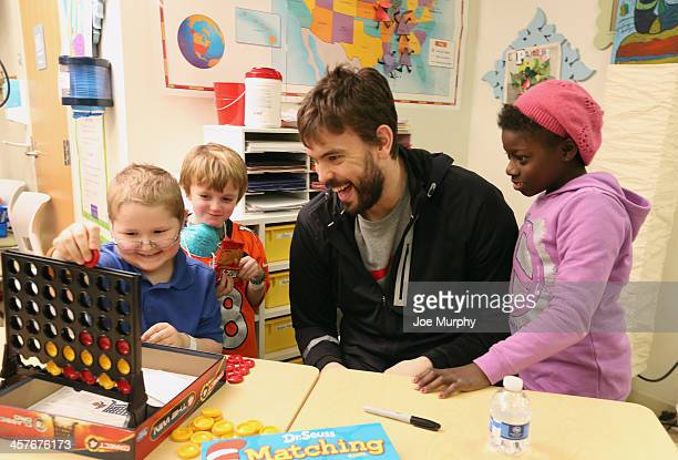 Marc Gasol of the Memphis Grizzlies plays board games as he visits with children at St Jude Children's Research Hospital on December 17 2013 in...