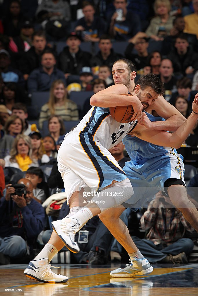 Marc Gasol #33 of the Memphis Grizzlies protects the ball against Kosta Koufos #41 of the Denver Nuggets on December 29, 2012 at FedExForum in Memphis, Tennessee.