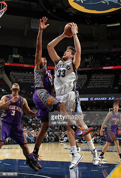 Marc Gasol of the Memphis Grizzlies shoots over Channing Frye of the Phoenix Suns on February 16 2010 at FedExForum in Memphis Tennessee NOTE TO USER...
