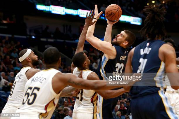 Marc Gasol of the Memphis Grizzlies shoots over Darius Miller of the New Orleans Pelicans during the second half of a NBA game at the Smoothie King...