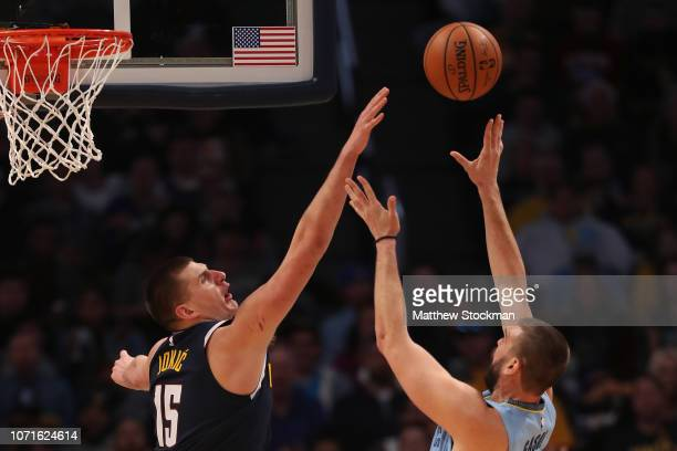 Marc Gasol of the Memphis Grizzlies throws up a shot against Nikola Jokic the Denver Nuggets at the Pepsi Center on December 10 2018 in Denver...