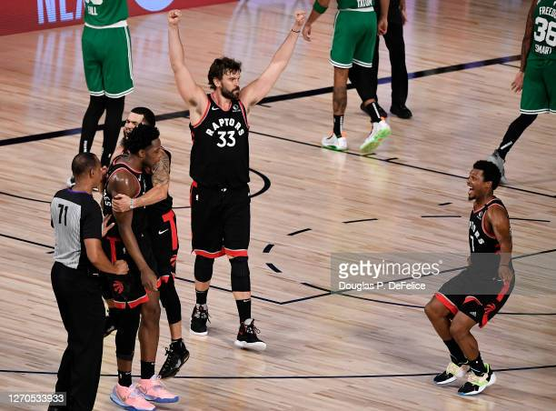 Marc Gasol of the Toronto Raptors and Kyle Lowry of the Toronto Raptors react after their win over Boston Celtics in Game Three of the Eastern...
