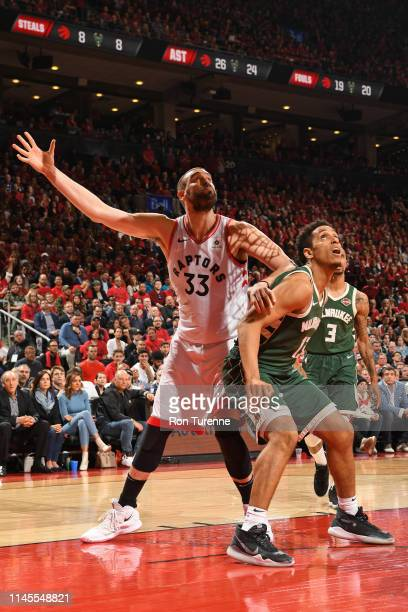 Marc Gasol of the Toronto Raptors and Malcolm Brogdon of the Milwaukee Bucks defend their positions during Game Four of the Eastern Conference Finals...