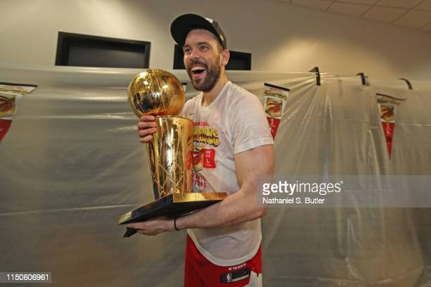 Marc Gasol of the Toronto Raptors holds the Larry O'Brien Championship Trophy in the locker room after defeating the Golden State Warriors in Game...
