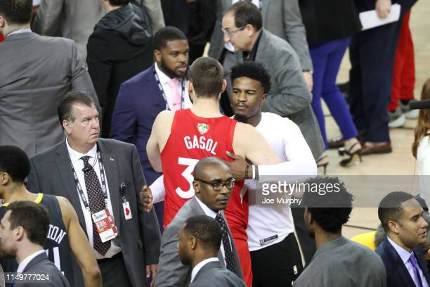 Marc Gasol of the Toronto Raptors hugs Jordan Bell of the Golden State Warriors after the Toronto Raptors win the game and become the 2019 NBA...