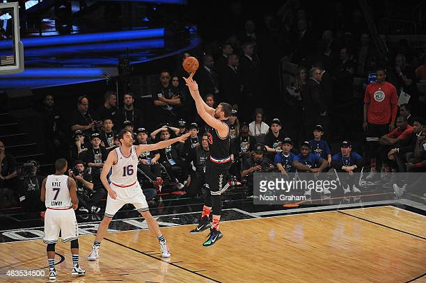 Marc Gasol of the Western Conference shoots against Pau Gasol of the Eastern Conference during the 64th NBA AllStar Game presented by Kia as part of...