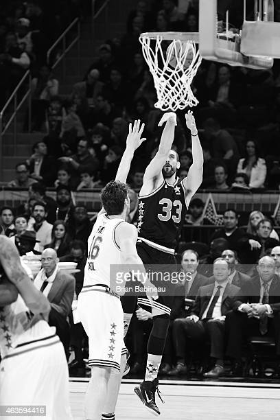 Marc Gasol of the Western Conference shoots the ball against the Pau Gasol of the Eastern Conference during the 2015 NBA AllStar Game as part of the...