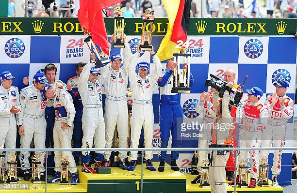 Marc Gene of Spain Alexander Wurz of Austria and David Brabham of Australia celebrating on the podium after driving their Peugeot Sport Total Peugeot...