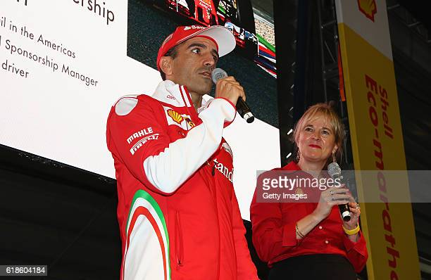 Marc Gene of Spain and Ferrari talks with Sydney Kimball Shell Retail Americas on stage at the Shell Eco Marathon event during the Formula One Grand...