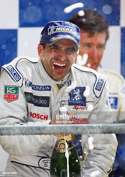 Marc Gene of Spain and Peugeot celebrates on the podium after winning the Le Mans 24h race on June 14 2009 in Le Mans France