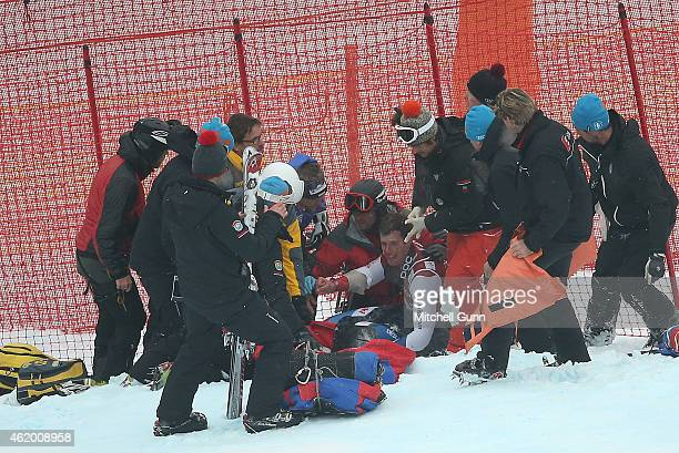 Marc Gisin of Switzerland is treated for facial injuries after crashing out during the Audi FIS Alpine Ski World Cup SuperG race on January 23 2015...