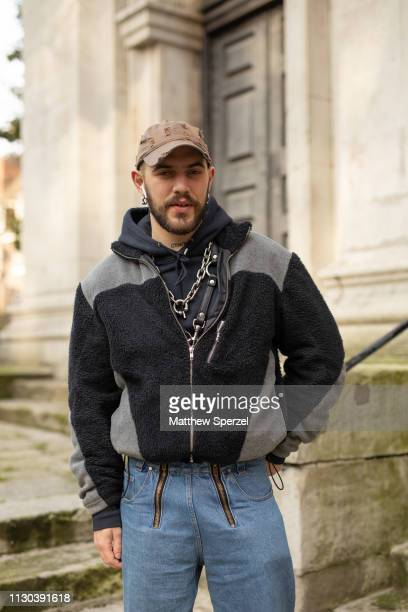 Marc Goehring is seen on the street during London Fashion Week February 2019 wearing taupe cap, black/grey jacket, black hoodie and jeans on February...
