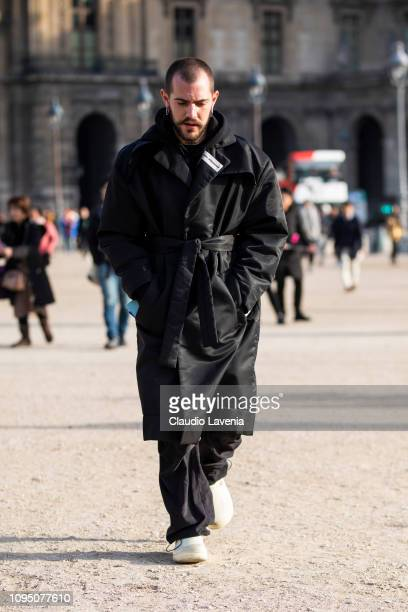 Marc Goehring wearing a long black coat black pants and white shoes is seen in the streets of Paris before the OffWhite show on January 16 2019 in...
