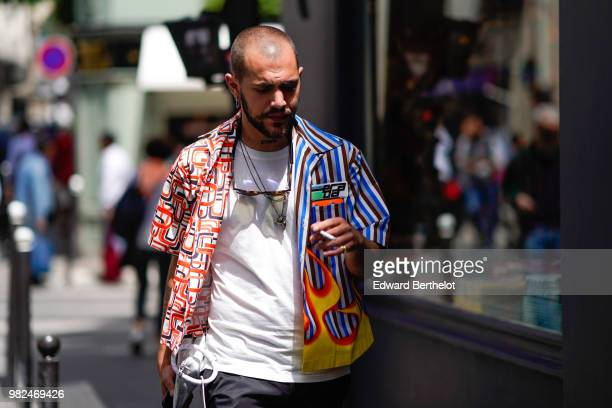 Marc Goehring wears a colored shirt outside Dior during Paris Fashion Week Menswear SpringSummer 2019 on June 23 2018 in Paris France