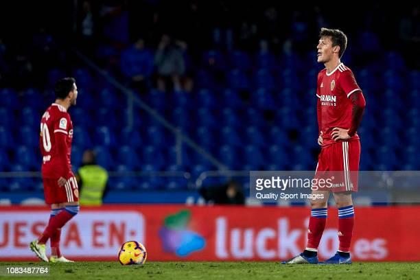 Marc Gual of Real Zaragoza reacts after Quique Gonzalez of Deportivo de La Coruna scored the third goal of Deportivo de La Coruna during the la Liga...